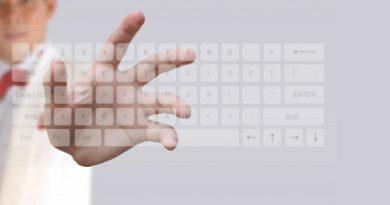 Businessman Pushing Keyboard